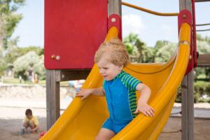 Toddler on Sliding Board
